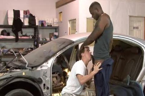White homo Mechanic acquires darksome poked At Work