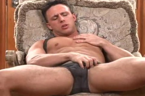 enrique tugging erect cock