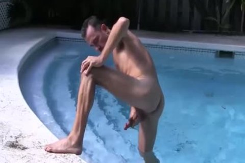 brunette hair chap Strokes His large pecker In The Pool