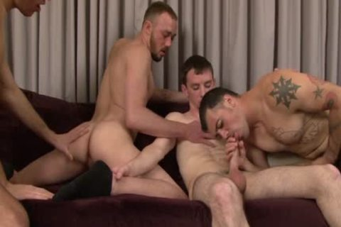 Four stylish pumped up guys enjoy Blowjobs