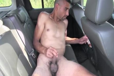 brunette chap Strokes A ramrod while In The Car