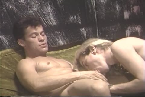Two guys Have A Great Time With Each Other On The daybed