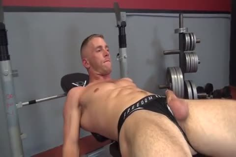 Two dudes plowing In The Gym