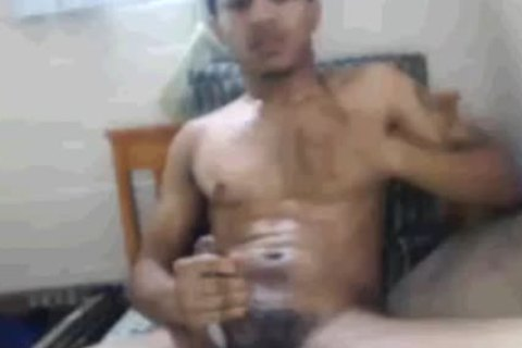 Tatted And Toned Blatino lad Masturbating In His sofa. (Slow clip scene)