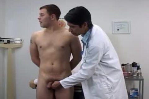Doctors Taking College boys Temperatures videos