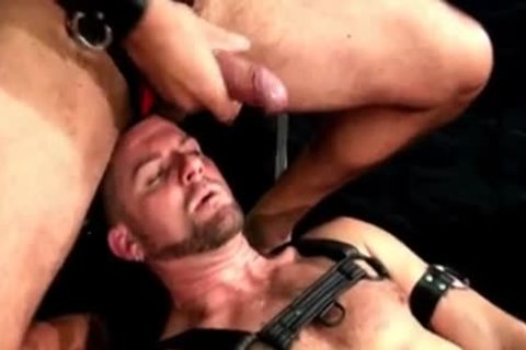 Leather man receives sex cream