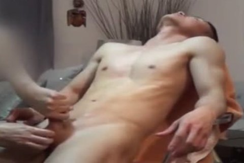Steamy twinks handjob on the sofa