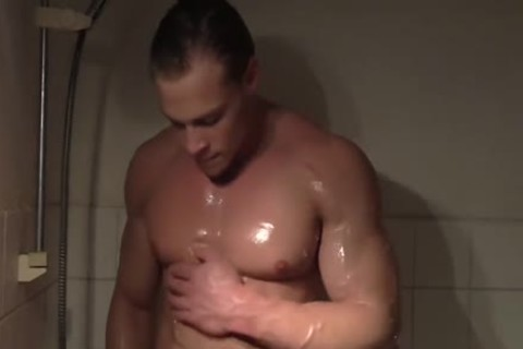 Muscle Hunk Taking A Shower