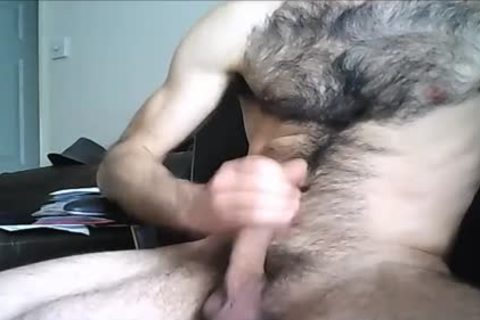 Hung dude Drenches His hirsute Chest