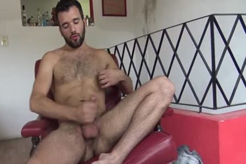 Two boys jerk on a red sofa