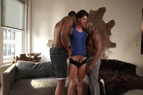 Two black males banging A White lad naked