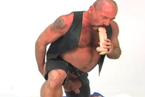 Butch leather wearing old chap w/ large dildo