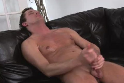 oiled up hunk masturbating on the daybed